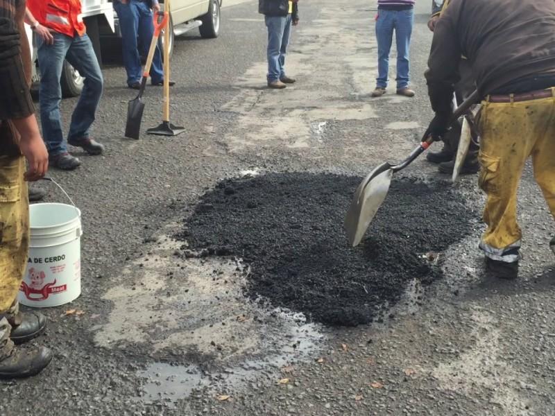 Buscan aplicar 110 mil bultos de asfalto frío