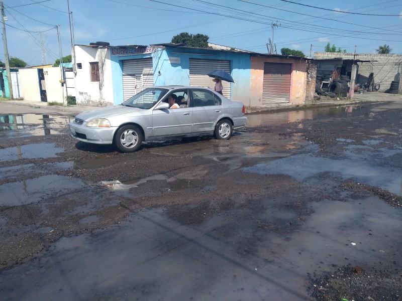 Calle Comunidad destrozada