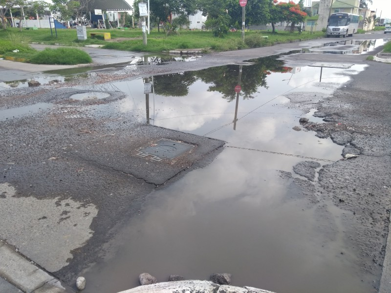 Calle de Arboledas San Ramón en malas condiciones