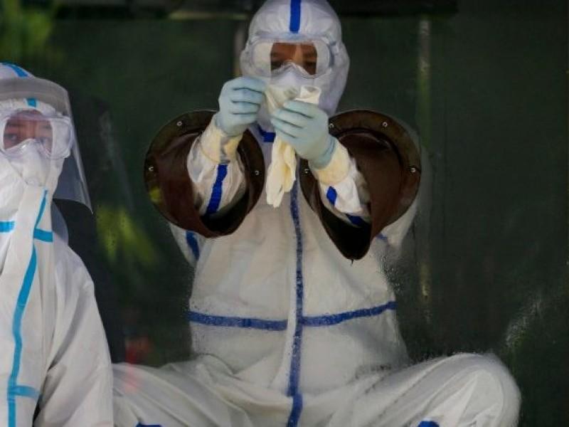 China reporta nuevo récord de infectados Covid-19