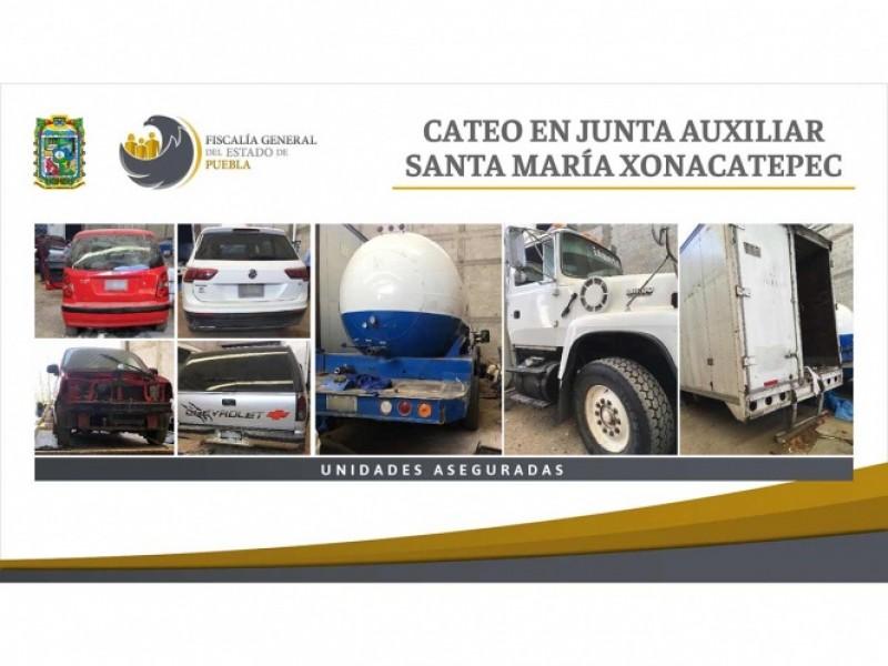 Fiscalía de Puebla catea domicilio y decomisa 7 vehículos robados