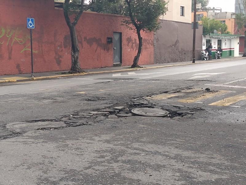 Lluvias provocan que asfalto se levanté