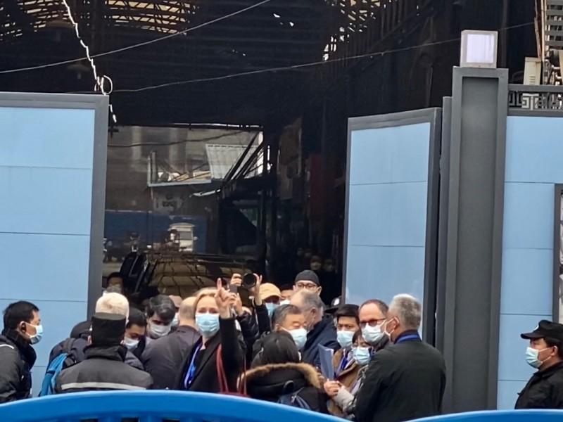 OMS llega al mercado de Wuhan para investigar origen Covid-19