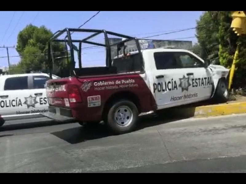Patrulla choca contra automóvil y deja lesionada a una mujer