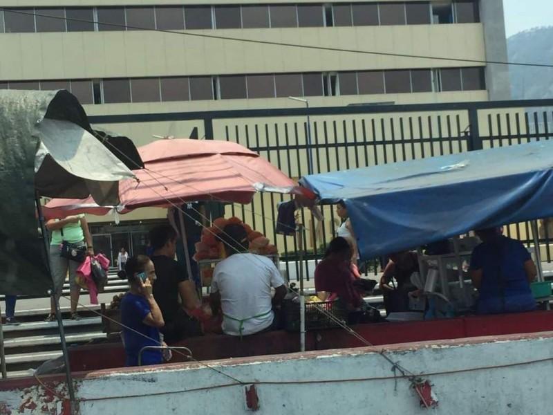 Por pérdida total comerciantes piden reinstalación en IMSS Tepic