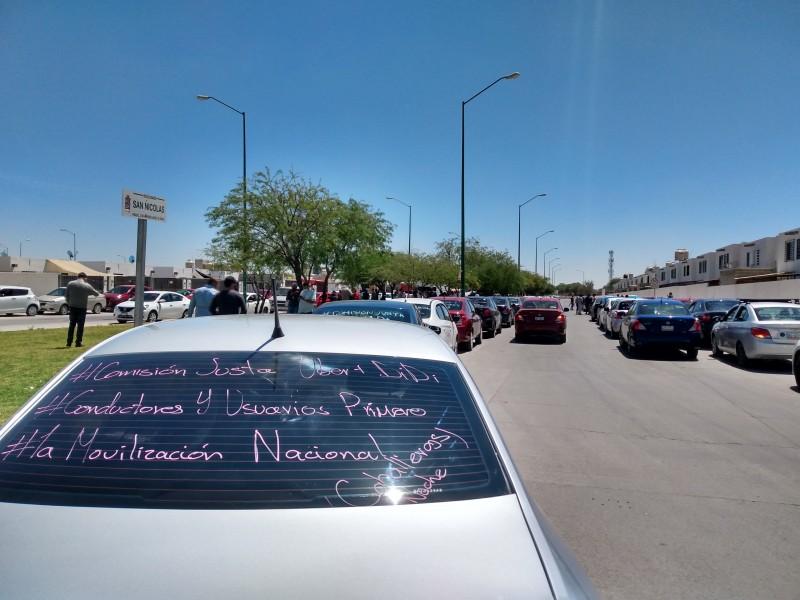 Protestan mil 500 operadores de Uber y Didi en León