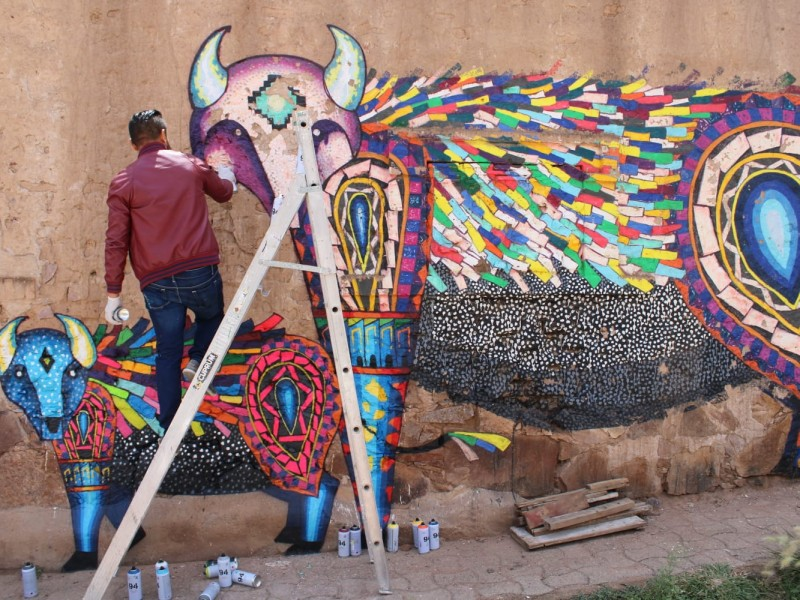 Restauran mural en comunidad de Palmillas