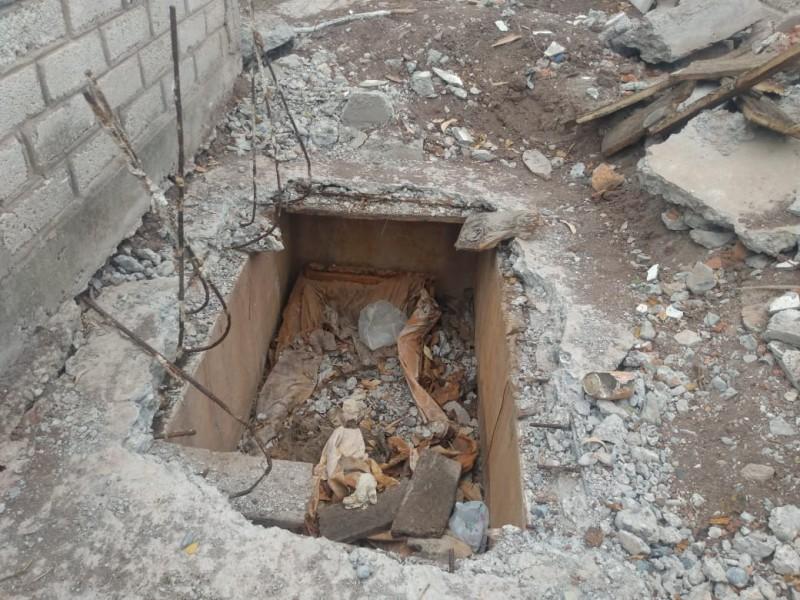 Sorprenden féretros y restos expuestos en panteón de Cortines