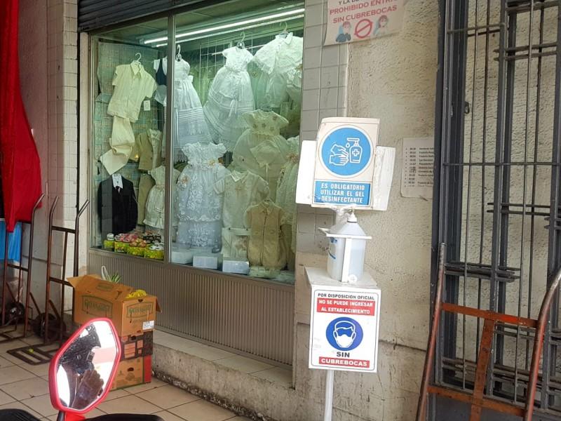 Temen comerciantes y consumidores nuevos cierres por aumento de casos