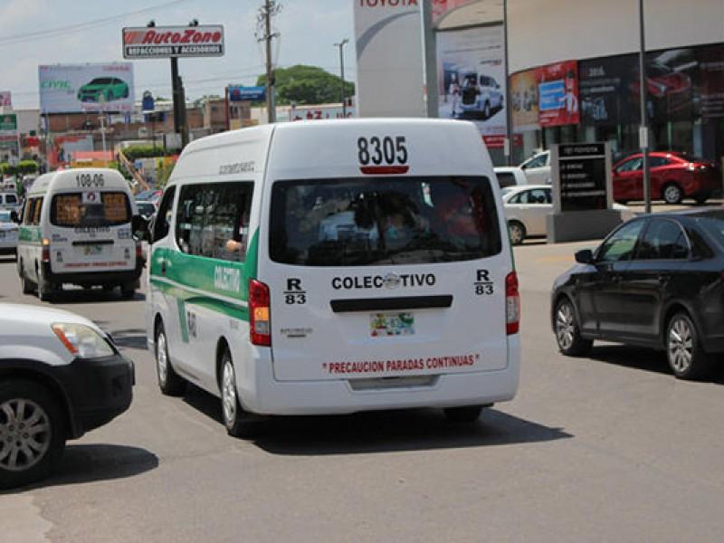 Transportistas por aumento de dos pesos al pasaje