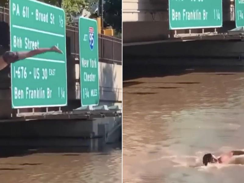 """Tras remanentes de """"Ida"""", hombre realiza salto de espalda, Filadelfia"""